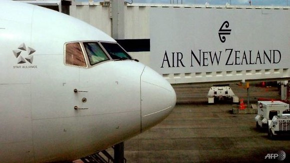An Air New Zealand Boeing 737 sits at a departure gate at Auckland Airport, Auckland. —AFP/VNA Photo