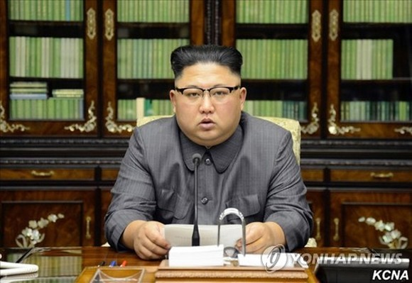"""This photo carried by North Korea's state news agency on Sept. 22, 2017 shows North Korean leader Kim Jong-un reading his statement condemning U.S. President Donald Trump for threatening to """"totally destroy"""" the North. (For Use Only in the Republic of Kor"""