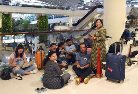 Tourists on Bali Island are stranded at an airport in Denpasar on Monday as their return flights were canceled following a volcanic eruption on the island. — KYODO/VNA Photo
