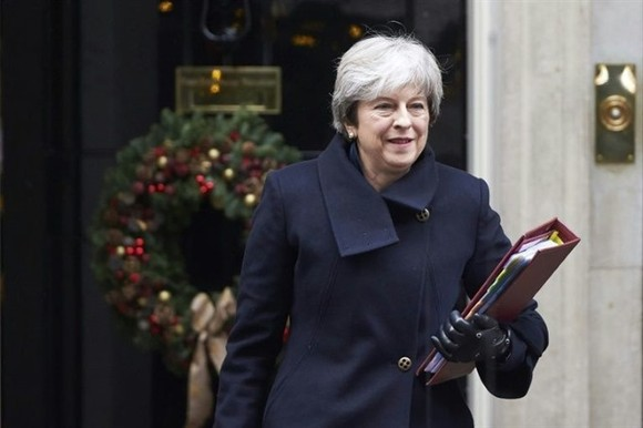 Theresa May's own lawmakers on Wednesday rebelled to demand that parliament has a say on any final Brexit deal. - AFP/VNA