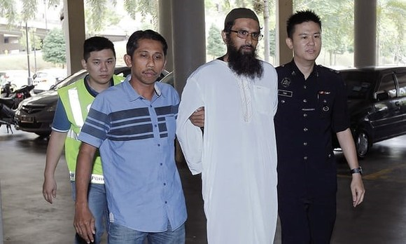 Salah Salem Saleh Sulaiman (second, right) became the first person to be convicted under Malaysia's new anti-fake news law (Photo: AP)
