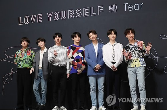 BTS poses for a photo session during a press conference on May 24, 2018. (Yonhap)