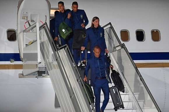 Brazil's Firmino, Danilo, Filipe Luis and Miranda descend from the plane upon the team's arrival at Sochi airport, in Russia on June 11, 2018, ahead of the FIFA World Cup. — AFP Photo