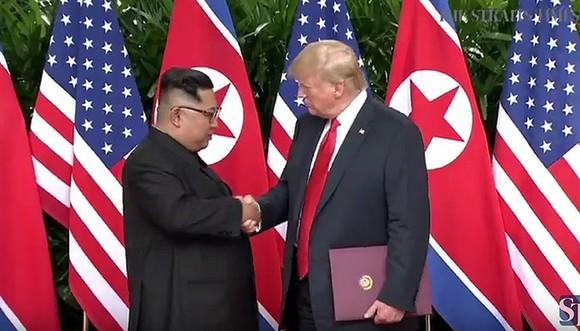 Trump, Kim sign agreementafter historic summit but few specifics