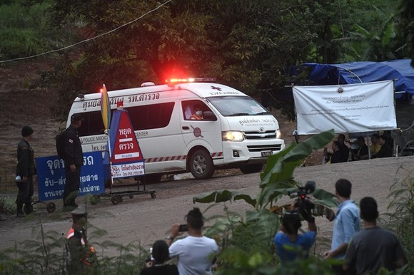 An ambulance leave the Tham Luang cave area as divers evacuated some of the 12 boys and their coach trapped at the cave in Khun Nam Nang Non Forest Park in the Mae Sai district of Chiang Rai province on Sunday. — AFP/VNA Photo