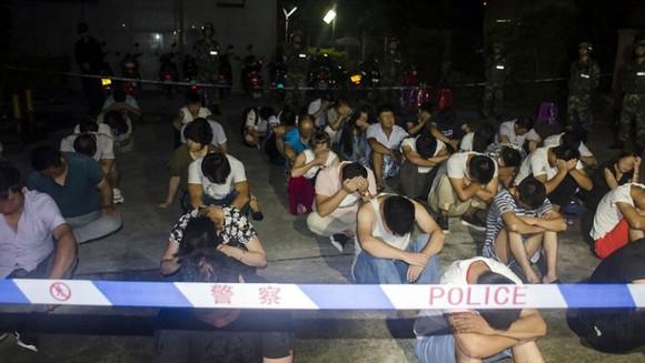 Hình ảnh vụ truy bắt đối tượng tham gia đường dây lừa đảo đa cấp ở TP Bắc Hải, khu tự trị dân tộc Choang, Quảng Tây, Trung Quốc