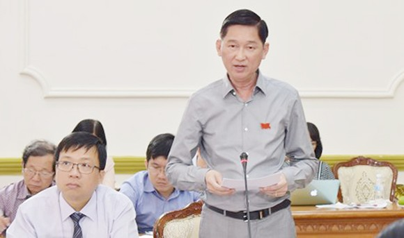 Phó Chủ tịch UBND TPHCM Trần Vĩnh Tuyến khẳng định sẽ xem xét, điều chỉnh chính sách theo hướng giảm thiểu ảnh hưởng đến người dân có đất ở những nơi được quy hoạch. Ảnh: KIỀU PHONG