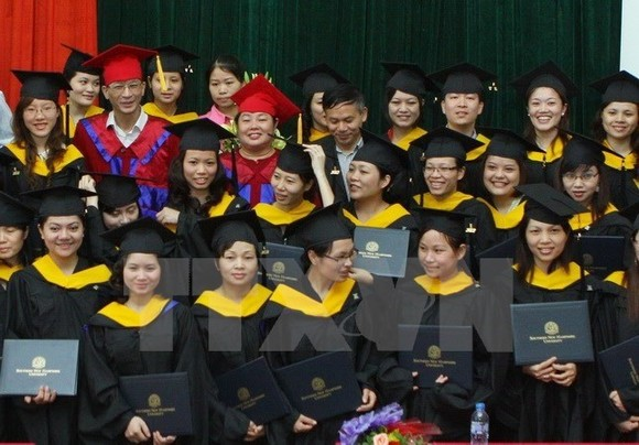 Graduates from University of Languages and International Studies under National University Hanoi at a graduation ceremony. ​(Source: VNA)