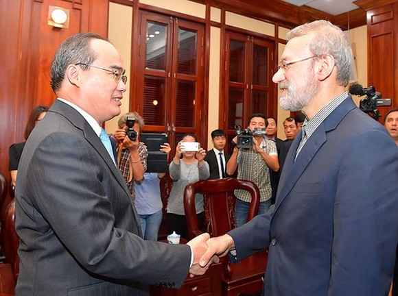 Secretary of the HCM City Party Committee Nguyen Thien Nhan (L) and Speaker of the Parliament of Iran Ali Ardeshir Larijani. (Photo: Sggp)