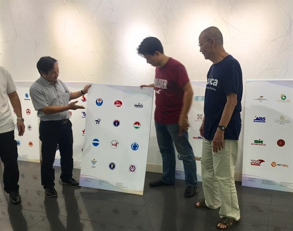 Getting ready: Organisers and logo designers are preparing for the Logo Việt Nam 2018 exhibition. — Photo courtesy of the organisers' board