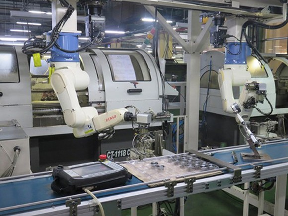 Robot hands in the assembly line of a manufacturing plant of Juki Company