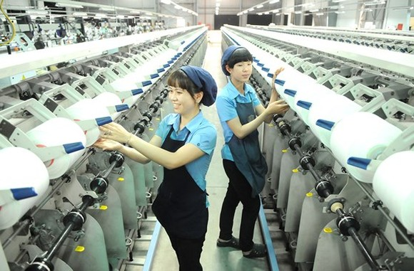 Workers of Thai Tuan Textile and Garment are producing commdities for exports to Middle East (Photo: SGGP)