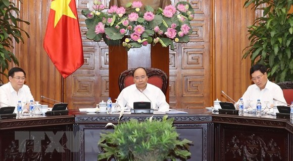 PM Nguyen Xuan Phuc orders stricter measures to prevent massive scrap imports. (Photo: VNA)