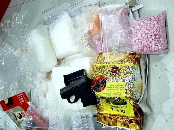 The drugs and weapon seized from the ring recently uncovered in HCM City (Source: VNA)