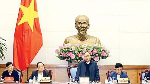 Vietnamese Prime Minister Nguyen Xuan Phuc at  a meeting about implementation of cooperation programs with Laos in 2017- 2018 (Photo:VNA)