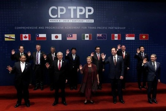 The Comprehensive and Progressive Agreement for Trans-Pacific Partnership was signed in Chile on March 8 (local time). (Photo: AFP/VNA)