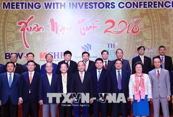 Prime Minister Nguyen Xuan Phuc (middle, front) and delegates at the conference (Photo: VNA)
