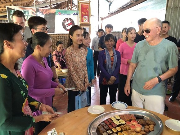 British billionaire Joe Lewis enjoys traditional cakes made by artisans in Con Son islet.