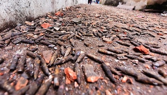 A road is full with bullet warheads after the explosion in Quan Do hamlet