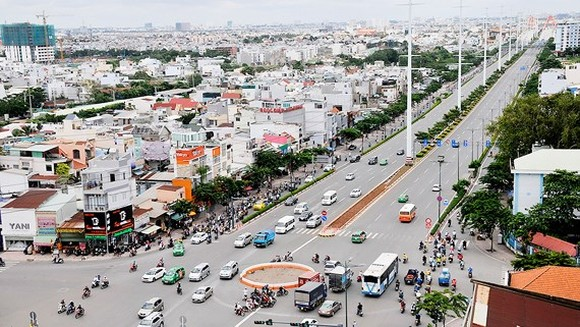 Pham Van Dong street connects Tan Son Nhat International Airport with HCMC's eastern entrance gateway (Photo: SGGP)