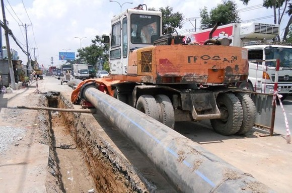 HCMC is striving to develop its urban infrastructure to provide safe water, control flooding and reduce traffic congestion. (Photo: thesaigontimes.vn)