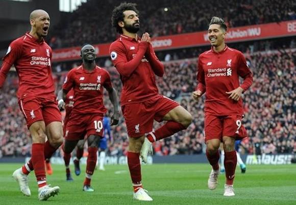 Mohamed Salah trình làng động tác mới khi ăn mừng bàn thắng. Ảnh: Getty Images