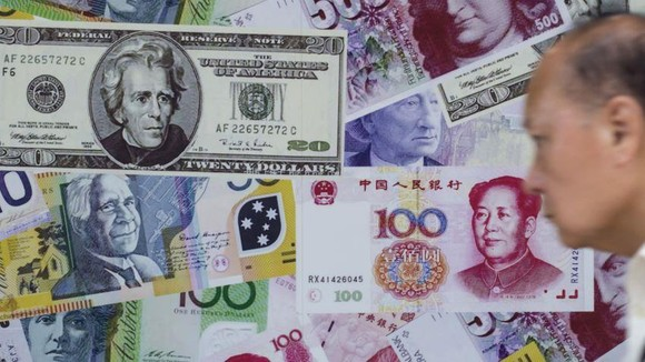 Spot rates for the yuan slid to 7.0536 against the dollar on Tuesday, as more investors sold the Chinese currency.    © Reuters