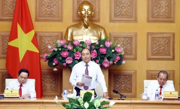 Thủ tướng Nguyễn Xuân Phúc phát biểu tại Hội nghị liên tịch thường niên giữa Chính phủ và Ủy ban Trung ương Mặt trận Tổ quốc Việt Nam. Ảnh: TTXVN