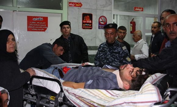 An earthquake victim is aided at Sulaimaniyah Hospital on Sunday, in Sulaimaniyah, Iraq. At least 135 people were killed and hundreds more injured when a 7.3-magnitude earthquake shook the mountainous Iran-Iraq border triggering landslides that were hinde