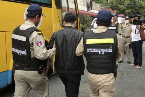 A suspect of the telecoms scam detained by Cambodian police (Source: wtop.com)