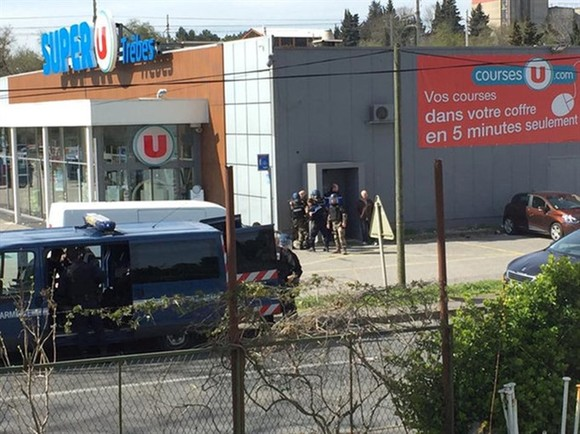 Police are seen at the scene of a hostage situation in a supermarket in Trebes, Aude, France on Friday in this picture obtained from a social media video. — REUTERS