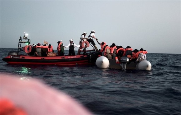 Migrants on stranded rescue ship head for Spain