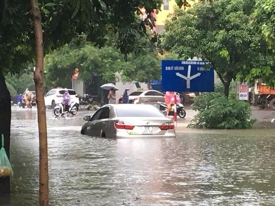Rains flood Hanoi's many streets