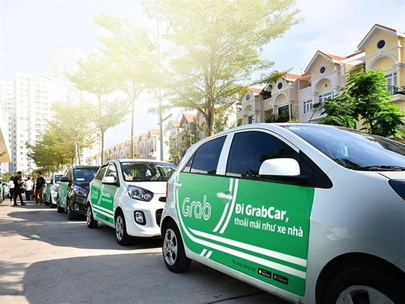 Grab cars (Photo: VNA)