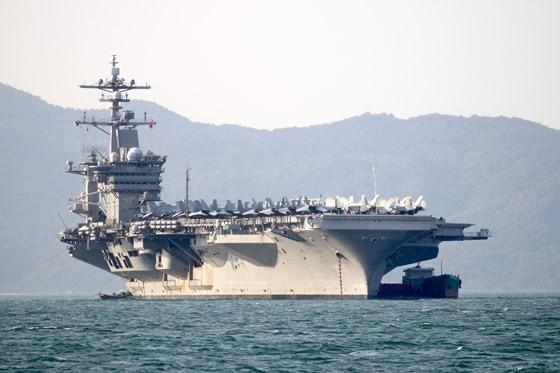 The USS Carl Vinson aircraft carrier docks at Tien Sa Port in the central coastal city of Da Nang.