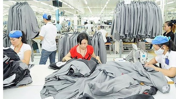 500 firms in Hanoi with huge overdue social insurance debt from 6 to 12 months (photo : sggp)