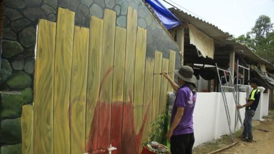 """Quảng Ngãi: Nghệ thuật """"phát sáng"""" ở làng bích họa ảnh 1"""